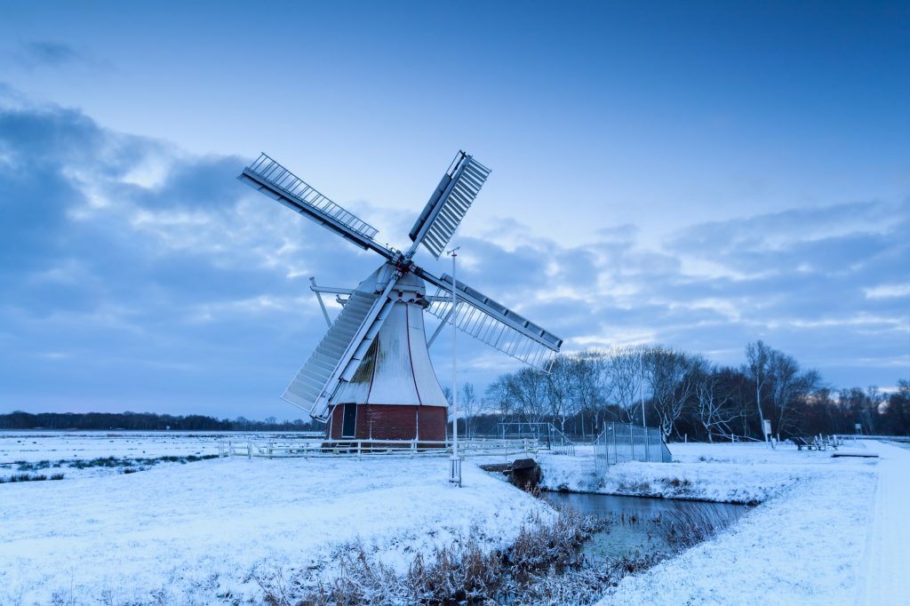 white windmill on snow